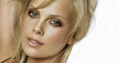 Charlize Theron jokes 'I want to punch Michael Fassbender in the face'